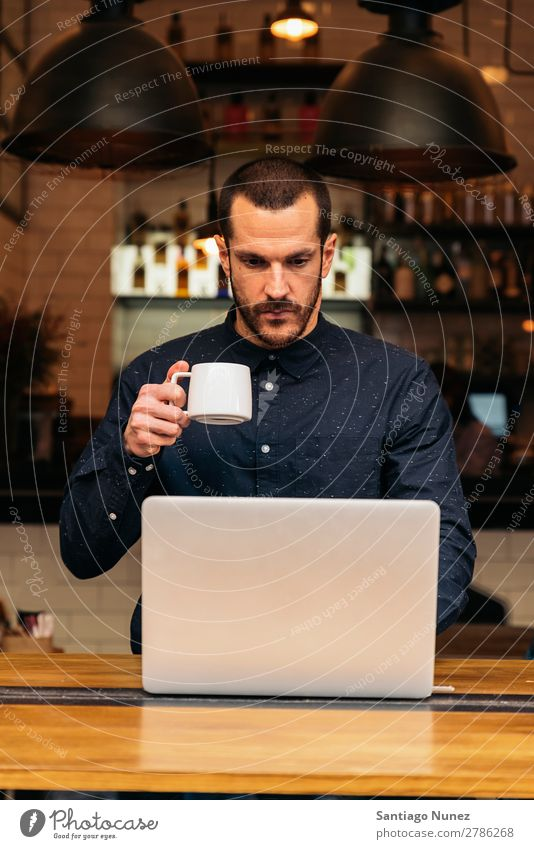 Businessman using his laptop in the Coffee Shop coffee friendly portrait young people lifestyle business businessman communication smartphone cellphone mobile