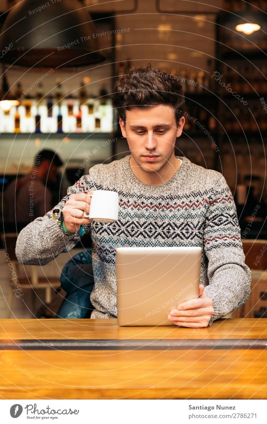 Businessman using his laptop in the Coffee Shop. Man Friendliness Portrait photograph Youth (Young adults) Human being Lifestyle Communication PDA Cellphone