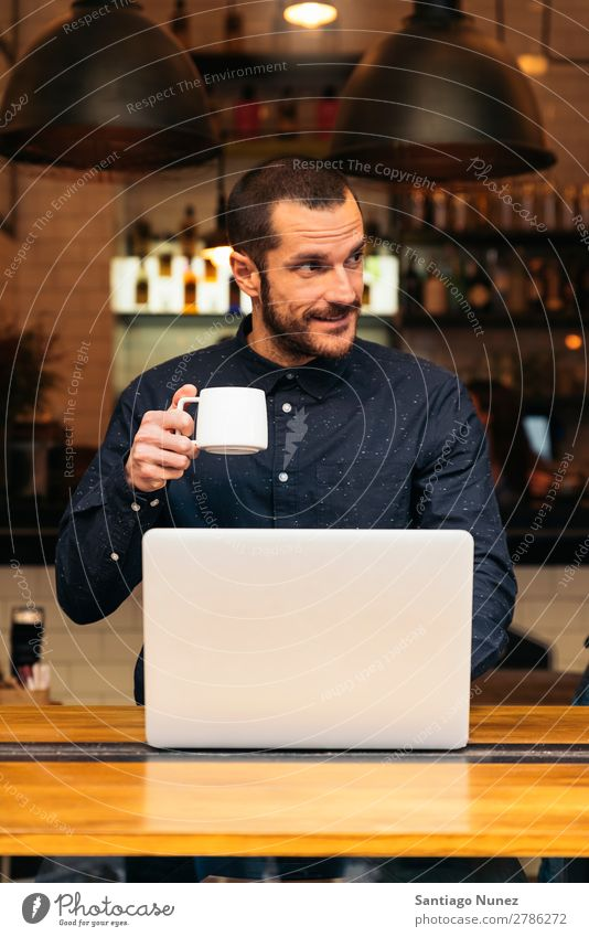 Businessman using his laptop in the Coffee Shop. Man Friendliness Youth (Young adults) Portrait photograph Human being Lifestyle