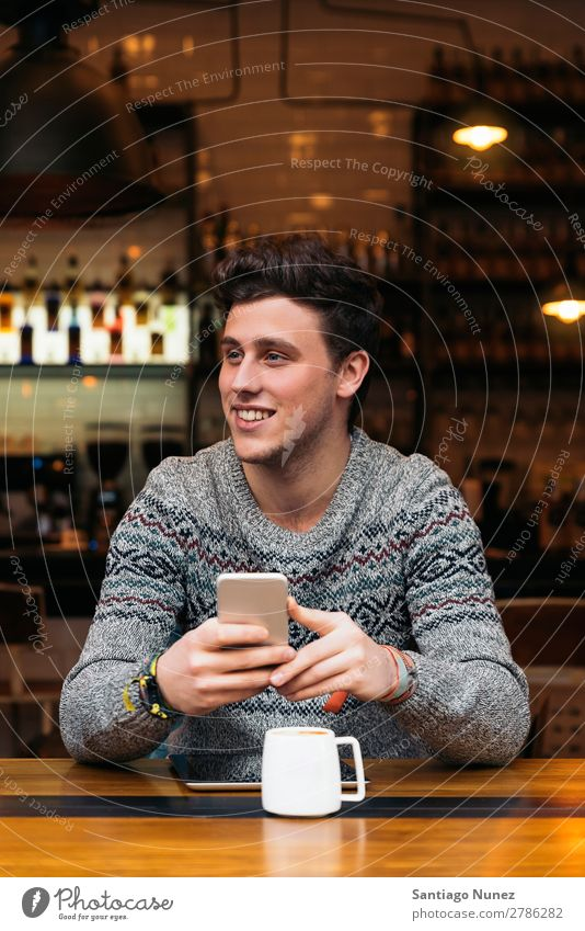 Businessman using his mobile in the Coffee Shop. Man Friendliness Portrait photograph Youth (Young adults) Human being Lifestyle