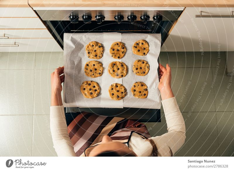 Beautiful woman Preparing Cookies And Muffins. Baking Stove & Oven biscuit chef Woman Decoration Delicious Home-made Cooking Egg Sugar Butter Lemon Flour Food