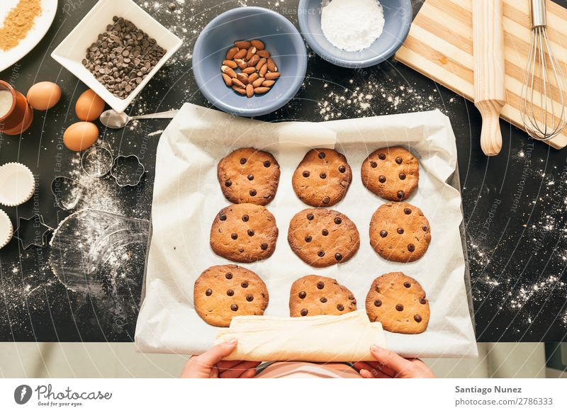 Beautiful woman Preparing Cookies And Muffins. Baking biscuit chef Woman Decoration Delicious Home-made Cooking Egg Sugar Butter Lemon Flour Food utensil Mold