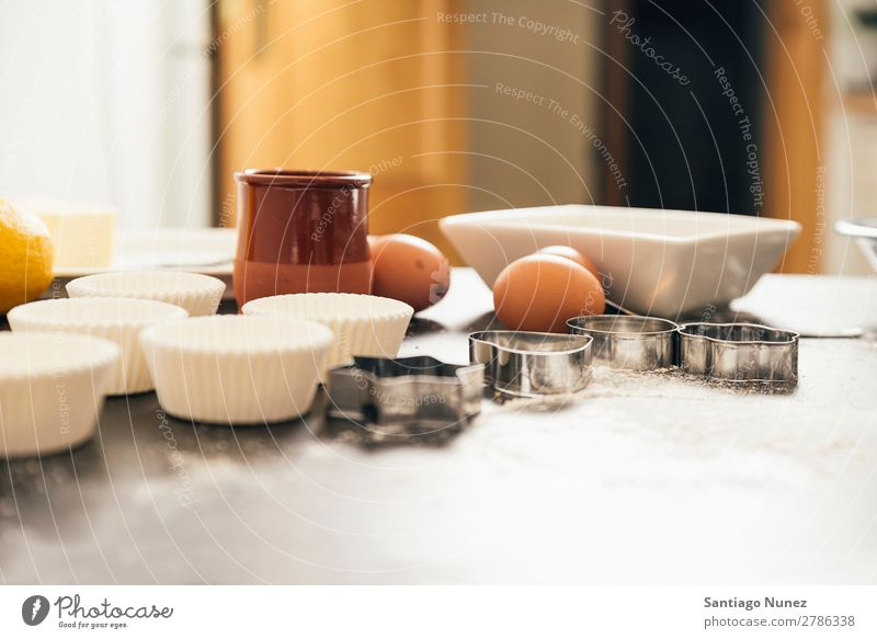Beautiful woman Preparing Cookies And Muffins Baking biscuit chef Woman Decoration Delicious Home-made Cooking Egg Sugar Butter Lemon Flour Food utensil Mold