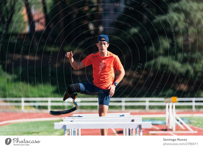 Disabled man athlete training with leg prosthesis. Man Running Runner Fitness Jump Athlete Sports prosthetic Handicapped disabled paralympic amputation amputee