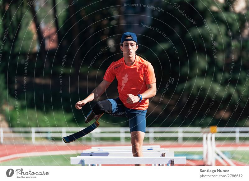 Disabled man athlete training with leg prosthesis. Man Running Runner Fitness Jump Athlete Sports prosthetic Handicapped disabled amputation amputee invalid