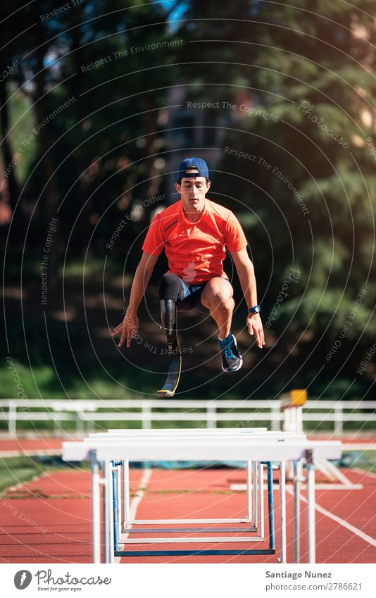 Disabled man athlete training with leg prosthesis. Man Running Runner Jump Athlete Sports prosthetic Handicapped disabled paralympic amputation amputee invalid
