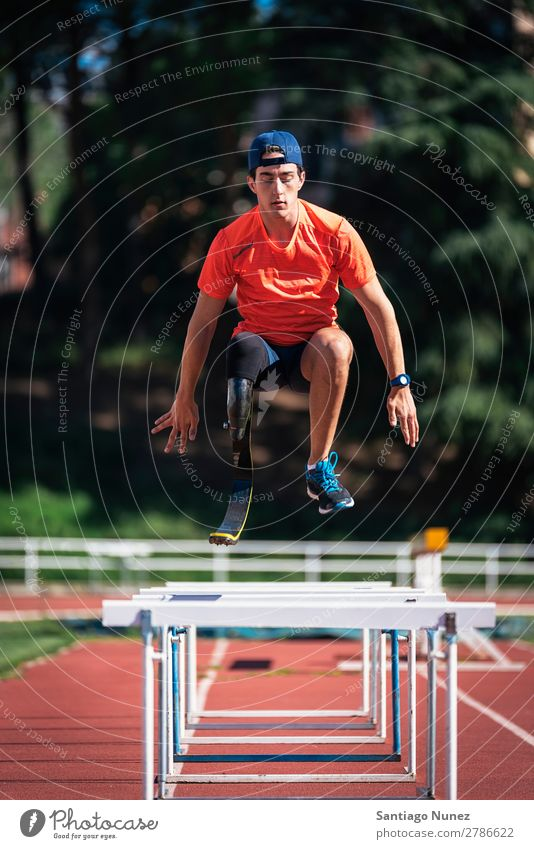 Disabled man athlete training with leg prosthesis Man Running Runner Jump Athlete Sports prosthetic Handicapped disabled amputation amputee invalid invalidity
