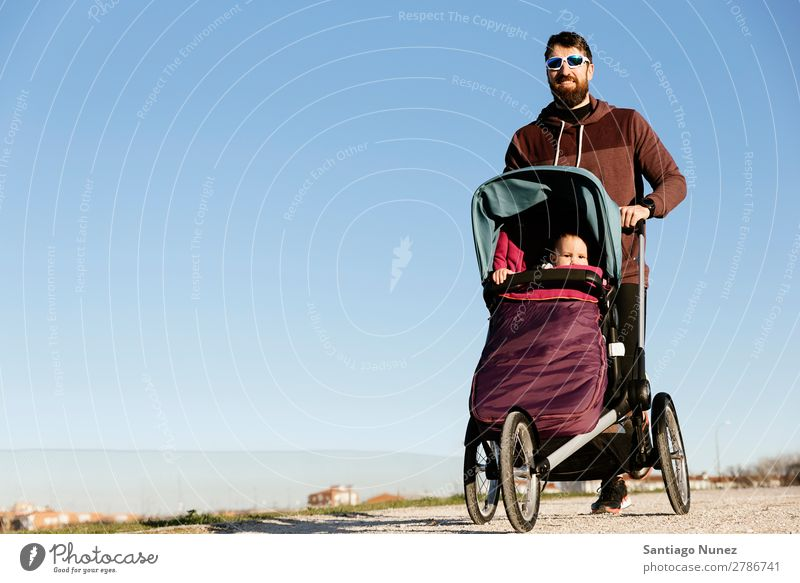 Father and son running in the park. stroller Jogging Running Walking Buggy (Motorbike) Family & Relations Baby Child Youth (Young adults) Daughter Son