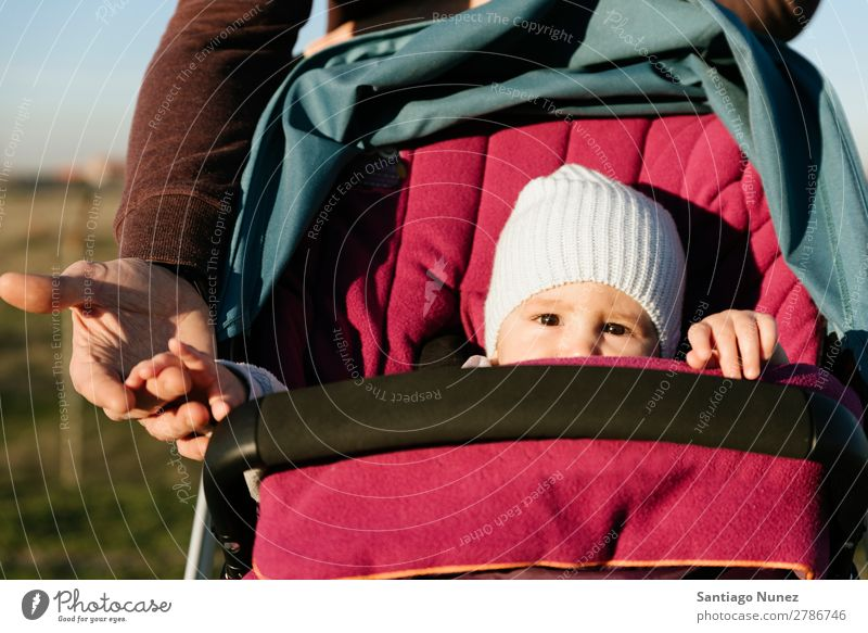 Little toddler in sitting stroller. Baby Carriage Baby carriage Nature Summer Father Parents Winter Day Sunbeam Sit Small Toddler Youth (Young adults) Girl