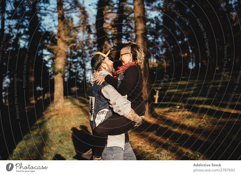 Happy young couple hugging in park Couple Embrace Park Tree Wood Hand Forest Youth (Young adults) Cheerful bearded Man Going Woman Joy embracing Hipster Walking