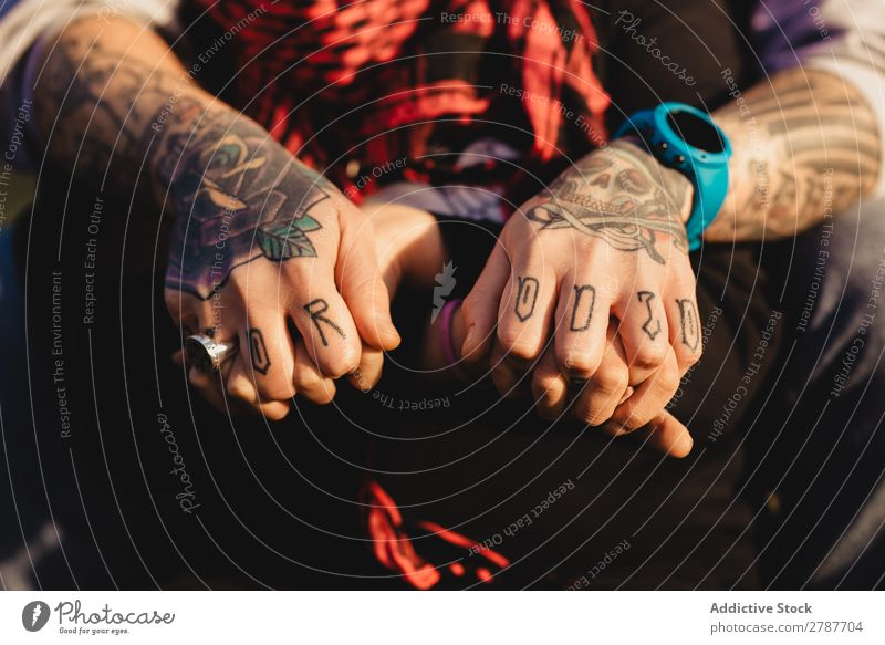 Man in tattoos holding hands of woman Couple Tattoo Ring Observe Scarf Weather Sunbeam Red Youth (Young adults) Woman Hipster embracing Time gem sash Embrace