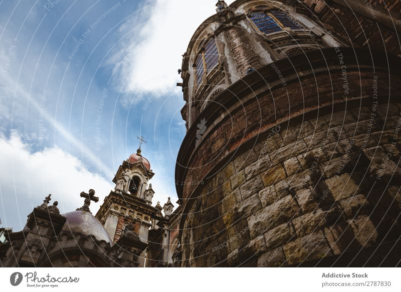 Old tower of cathedral and blue sky Tower Cathedral Sky Monastery Clouds Heaven Ancient Blue Religion and faith Building Stone Height Facade Beautiful Tourism