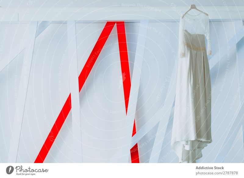 Wedding dress hanging on hanger Dress Hanger bridal Fashion Beautiful Elegant White Hanging Conceptual design Light Decoration Abstract Wall (building)