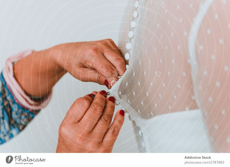 Woman buttoning up wedding dress on lady Wedding Dress Hand Lady Youth (Young adults) Back