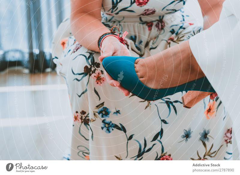 Woman wearing shoe on lady foot Footwear Feet Wear Dress Help Legs Lady