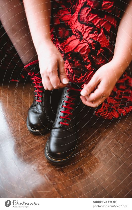 Woman in dress lacing boots Boots Dress Room Story Wood Red Lady