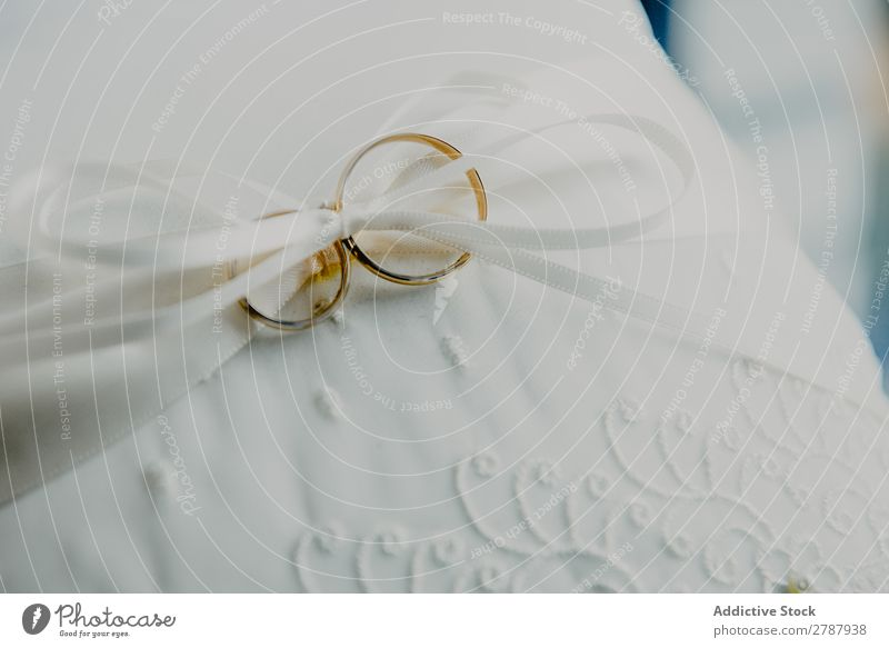 Golden wedding rings on white textile Ring Wedding White Material String