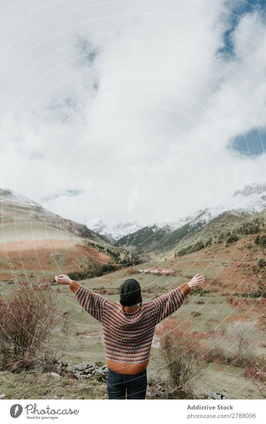 Young woman standing in a beautiful landscape between mountains Woman Mountain Pyrenees arms up Side Lady Sweater Hat Hill Snow Wonderful Youth (Young adults)