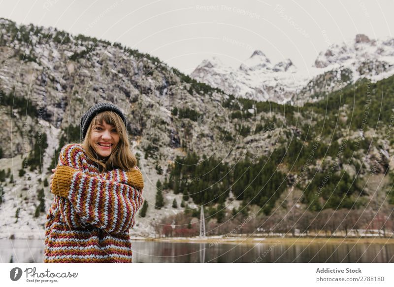 Young woman with crossed hands near mountain Woman Mountain Crossed Hand Pyrenees Lady Sweater Hat Hill Cold Looking into the camera Attractive Wonderful