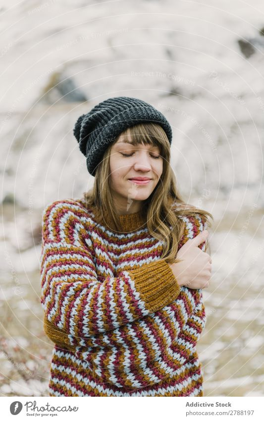 Young woman with crossed hands near mountain Woman Mountain Crossed Hand Pyrenees Lady Sweater Hat