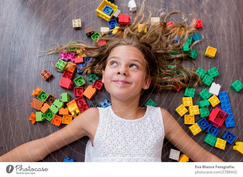 portrait of a Cute preteen girl playing at home Joy Happy Leisure and hobbies Playing Kindergarten Child School Feminine Girl Infancy Fingers 1 Human being