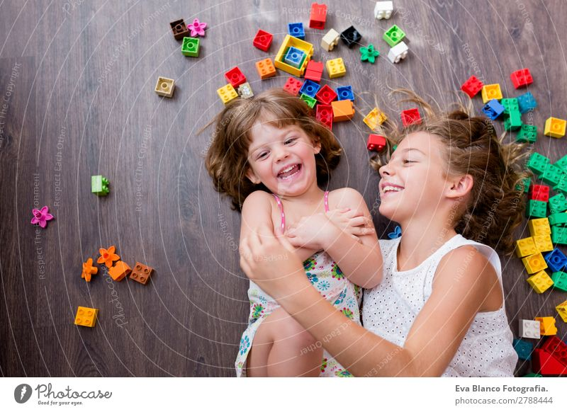 two beautiful sisters playing at home Child Human being Beautiful House (Residential Structure) Joy Girl Lifestyle Wood Emotions Family & Relations Laughter
