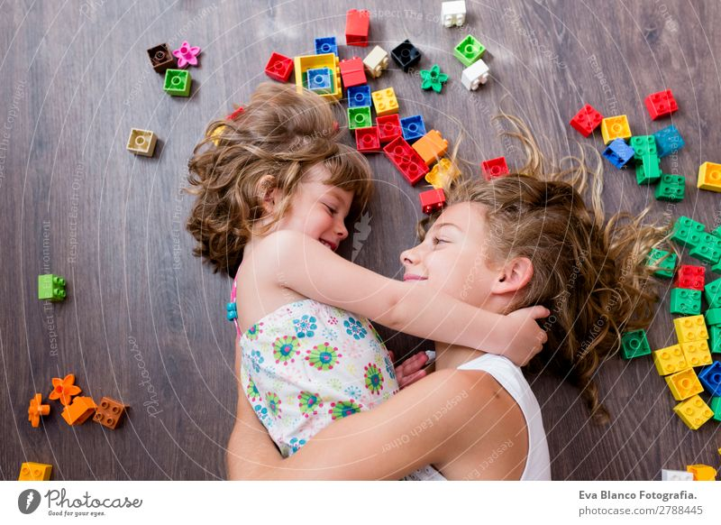 two beautiful sisters playing at home Lifestyle Joy Happy Leisure and hobbies Playing House (Residential Structure) Bed Kindergarten Child School Feminine Baby