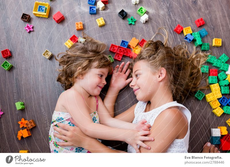 two beautiful sisters playing at home Child Human being Beautiful House (Residential Structure) Joy Girl Lifestyle Wood Love Feminine Family & Relations