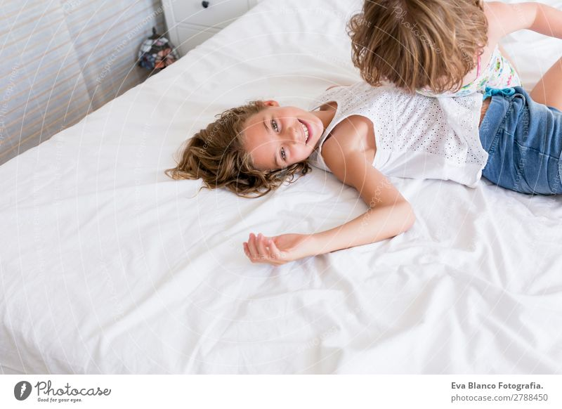Two beautiful sisters playing on bed Child Human being Youth (Young adults) Summer Beautiful White House (Residential Structure) Joy Girl Lifestyle Adults Love