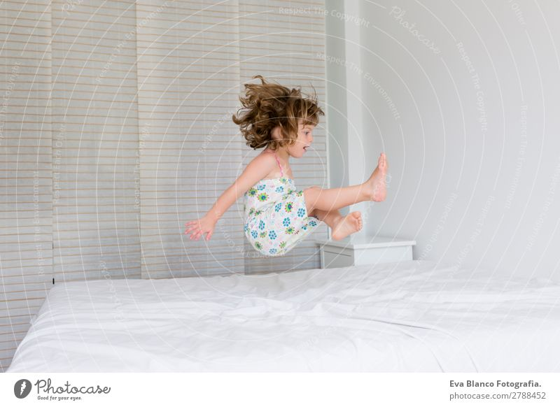 beautiful kid girl jumping on bed Lifestyle Joy Beautiful Leisure and hobbies Playing Summer House (Residential Structure) Bed Bedroom Child Human being