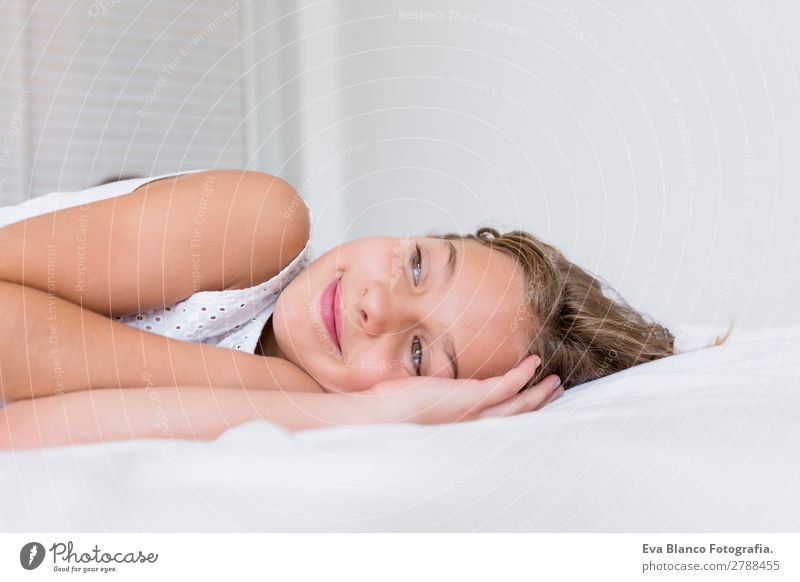 beautiful kid resting on bed and smiling Child Human being Summer Beautiful White House (Residential Structure) Relaxation Joy Girl Face Lifestyle Feminine