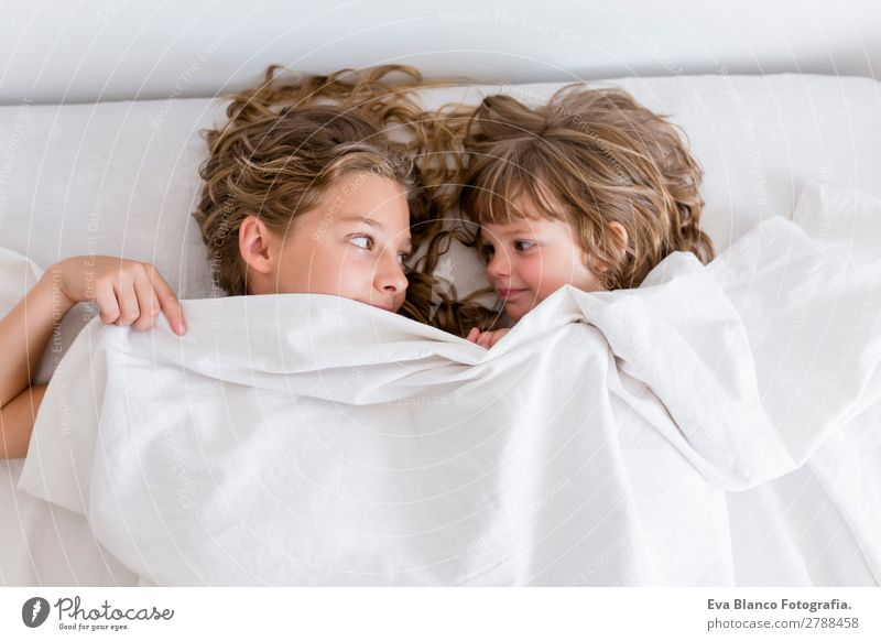 two young beautiful kids resting on bed Child Human being Beautiful White House (Residential Structure) Relaxation Joy Girl Lifestyle Love Feminine Emotions
