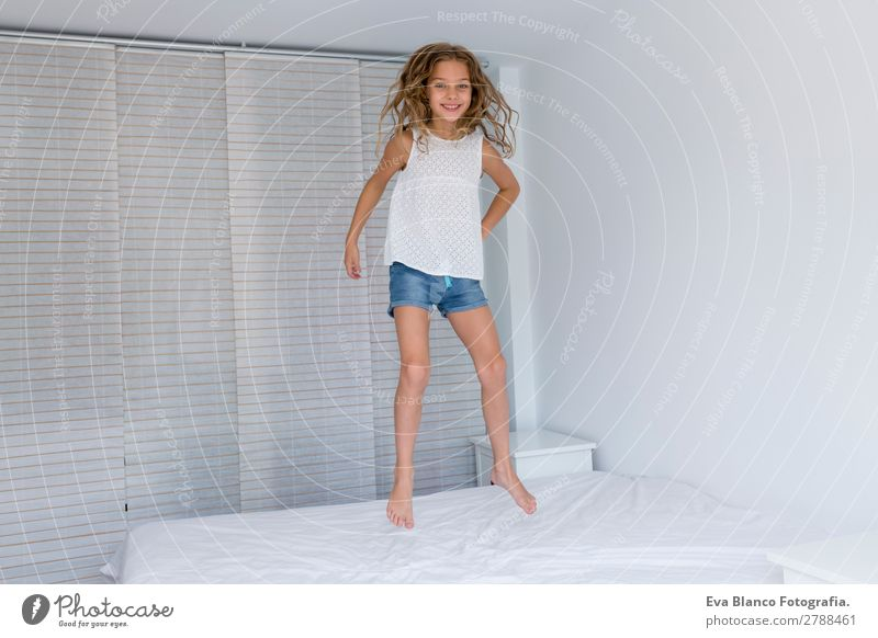 beautiful kid girl jumping on bed Child Human being Summer Beautiful White Joy Girl Lifestyle Adults Feminine Emotions Family & Relations Happy Playing Together