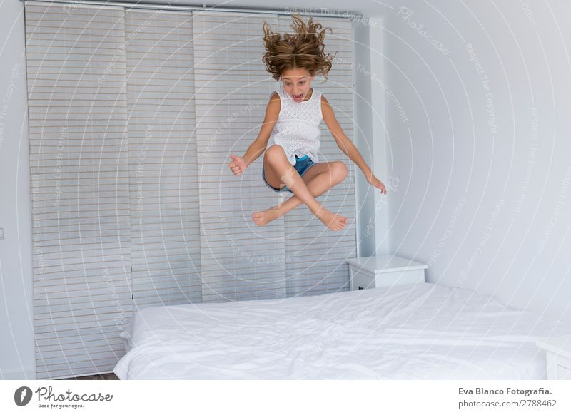beautiful kid girl jumping on bed Child Human being Summer Beautiful White House (Residential Structure) Joy Girl Lifestyle Feminine Emotions Family & Relations
