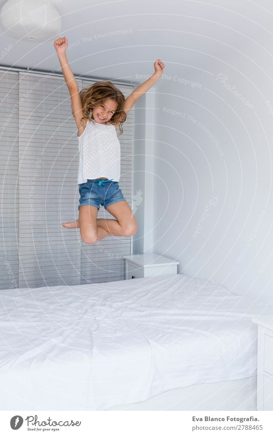 beautiful kid girl jumping on bed Child Human being Summer Beautiful White House (Residential Structure) Joy Girl Lifestyle Adults Feminine Emotions
