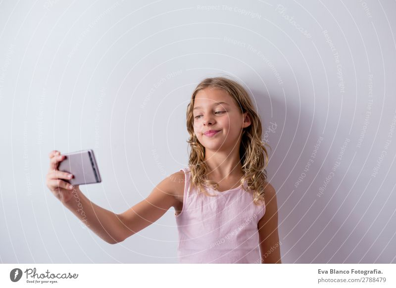 portrait of a beautiful kid using mobile phone Lifestyle Joy Beautiful Face Playing House (Residential Structure) Child Telephone Cellphone PDA Screen Camera