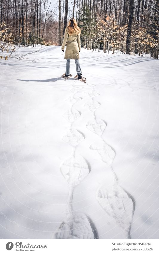 Young woman in snow shoes walking in winter forest Woman Human being Colour Relaxation Loneliness Forest Winter Lifestyle Adults Lanes & trails Snow Sports