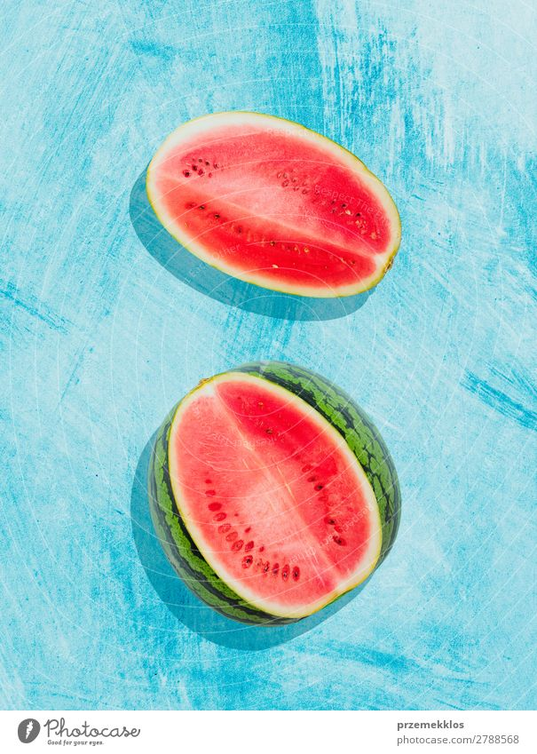 Pieces of watermelon on background painted in blue Fruit Nutrition Eating Vegetarian diet Diet Summer Fresh Delicious Natural Juicy Clean Green Red flat food