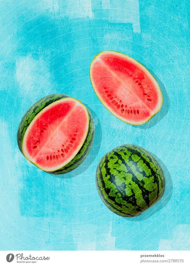 Pieces of watermelon on background painted in blue Fruit Nutrition Eating Vegetarian diet Diet Summer Fresh Bright Delicious Natural Juicy Clean Green Red flat