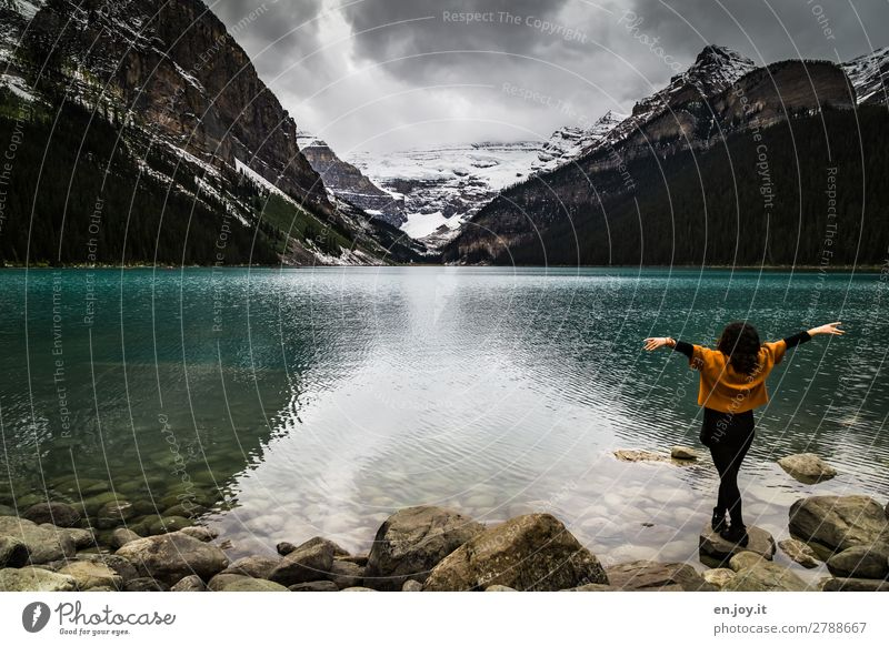 Woman Vacation & Travel Nature Youth (Young adults) Young woman Landscape Clouds Mountain Adults Emotions Happy Tourism Lake Rock Trip Stand