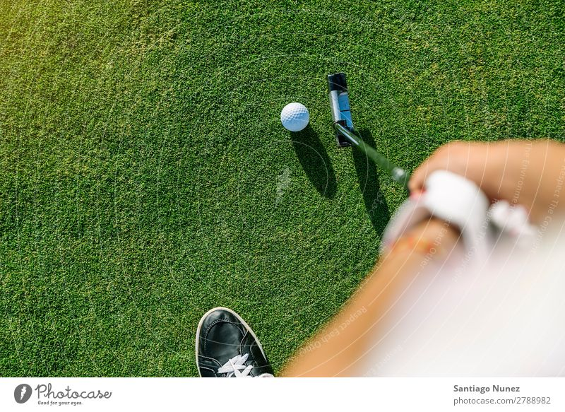 Woman golf player concentrating. Golf Player Girl Luxury Lifestyle Golfer Course (flight) Green Club Youth (Young adults) Close-up Hand Arm put Human being