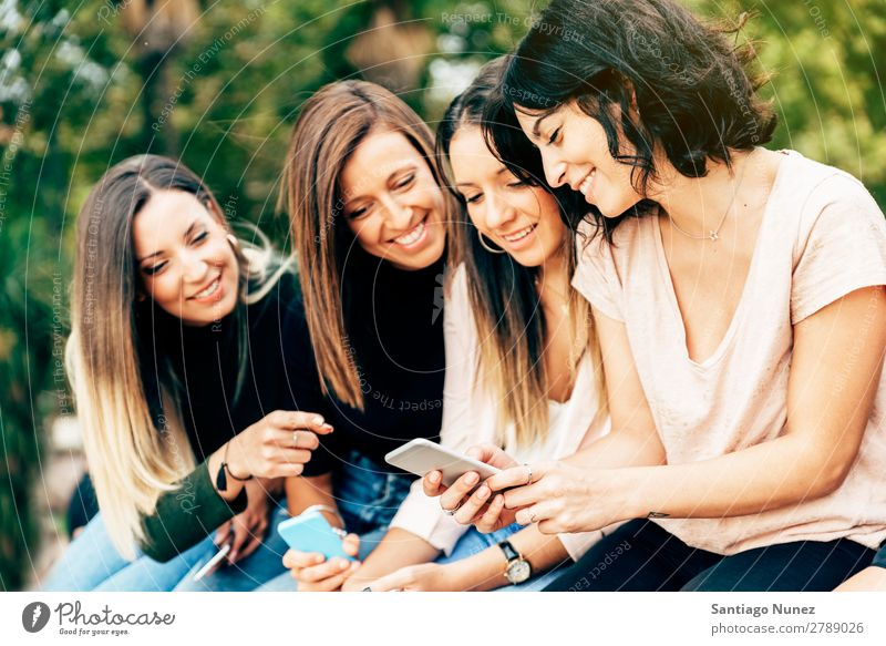 Big Group of friends using cellphones. Friendship Mobile Telephone PDA Human being Youth (Young adults) Woman Smart Technology Beautiful Lifestyle pretty