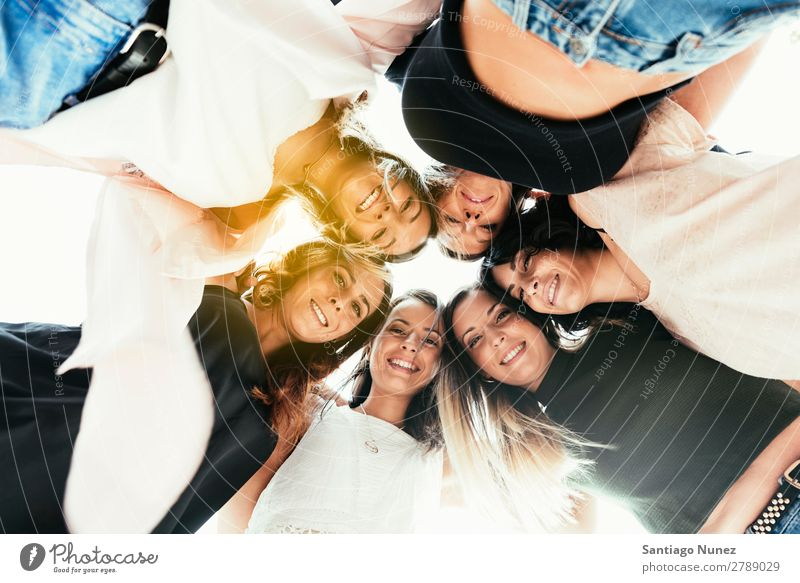 Women friends standing in circle. Human being Circle American Smiling Happy Peace Idea Bottom Woman Youth (Young adults) Adults Caucasian Exterior shot