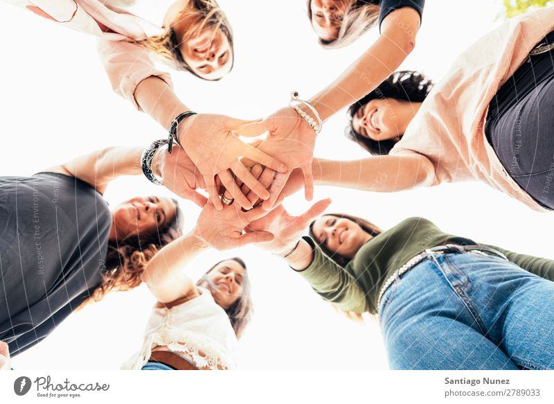 Friends with hands together. Adults American Easygoing Caucasian Close-up Friendship Smiling Happy Human being Conceptual design 6 Group Hand Idea Attachment