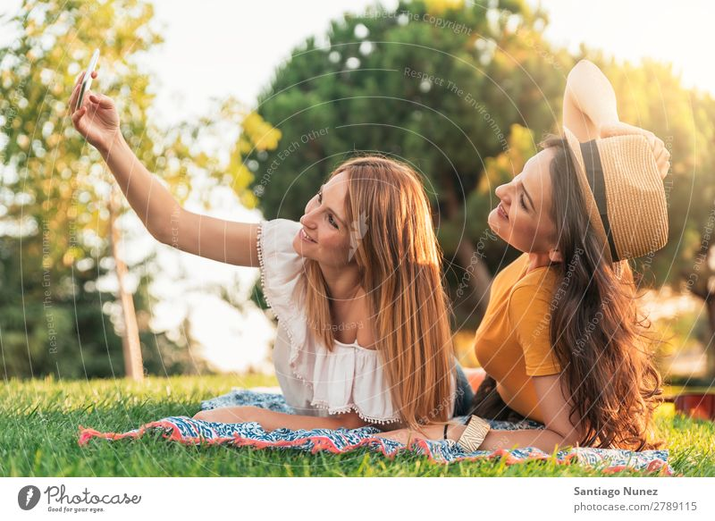 Beautiful women taking a selfie portrait in park. Woman Picnic Friendship Youth (Young adults) Park Happy Summer Human being Joy Mobile PDA Telephone Solar cell