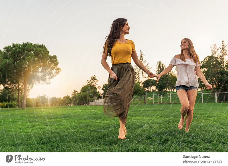 Beautiful women smiling and having fun and running. Woman Picnic Friendship Youth (Young adults) Running Hand Playing Park