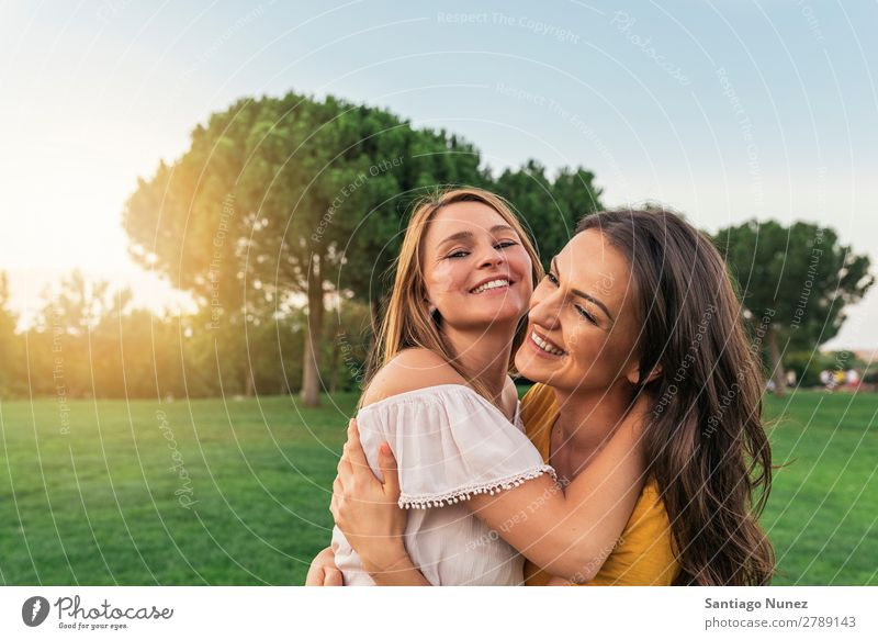 Beautiful women smiling and having fun in the park. Woman Picnic Friendship Youth (Young adults) Park Happy Embrace Summer Human being Joy Playing Adults Girl