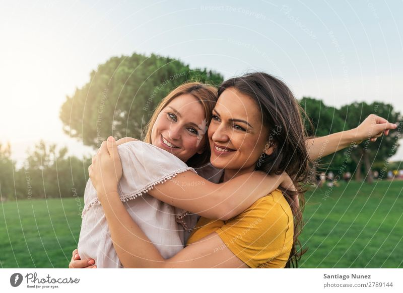 Beautiful women smiling and having fun. Woman Picnic Friendship Youth (Young adults) Park Happy Embrace Summer Human being Joy Playing Adults Girl pretty