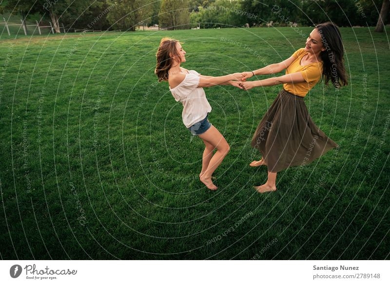 Beautiful women smiling and having fun. Woman Picnic Friendship Youth (Young adults) Hand Playing Park Happy Summer Human being Joy Funny Hold Teamwork