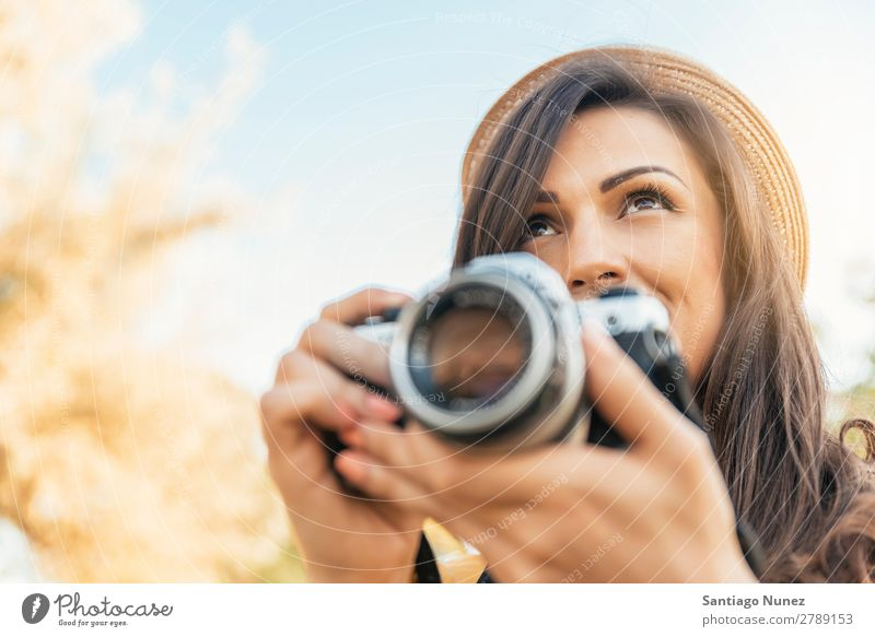 Young woman using a camera to take photo. Photographer Woman Photography Camera Youth (Young adults) Girl Digital White Leisure and hobbies 1 Take analogical